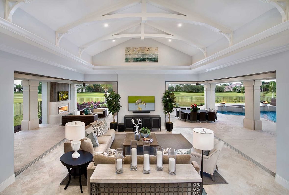 Cathedral ceiling in outdoor living space on golf course for Golf course house plans